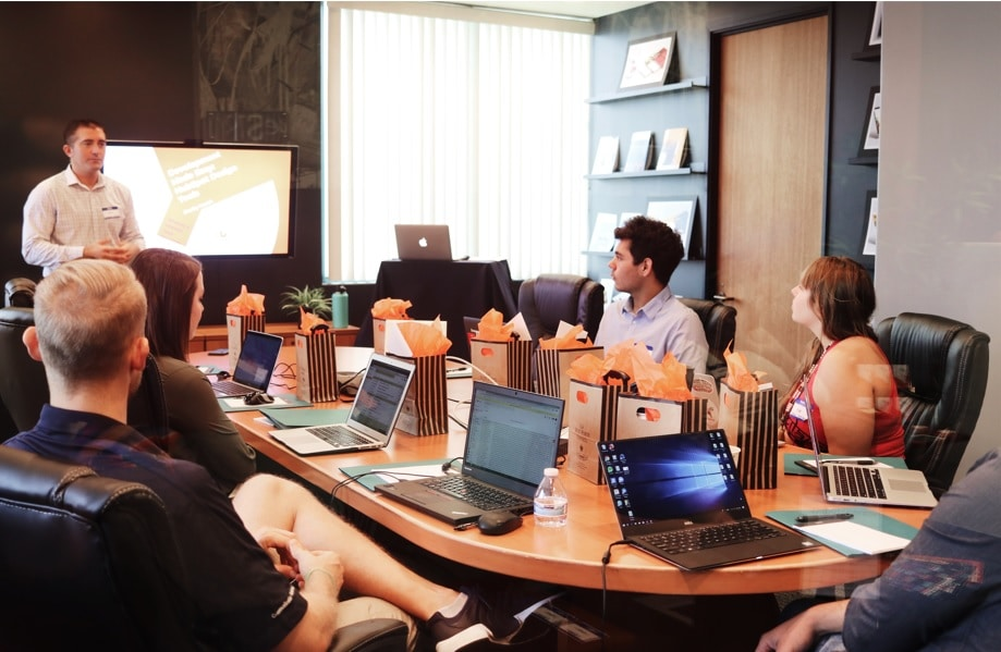 a group of peole at work watching a presentation