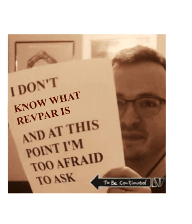"a man holding a papper saying ""I don't know what RevPar is"""